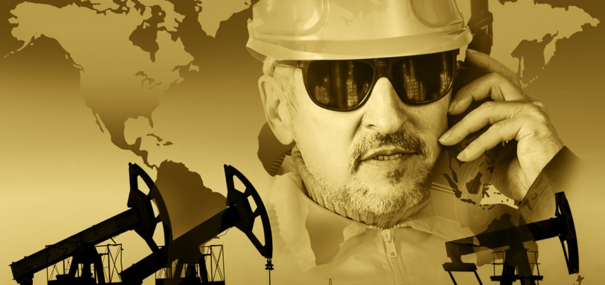Pump jack group, global map, worker in a oil industry background. Double exposure. Toned sepia.