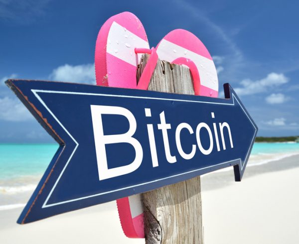 BITCOIN arrow on the beach
