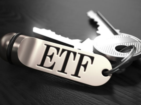 ETF - Exchange Traded Fund - Concept. Keys with Keyring on Black Wooden Table. Closeup View, Selective Focus, 3D Render. Black and White Image.