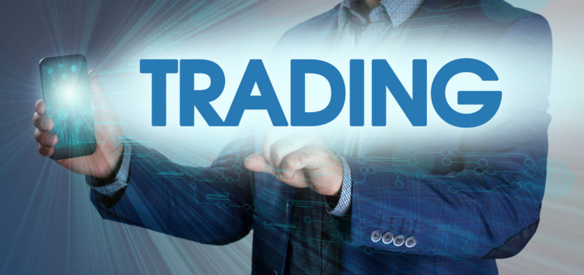 Businessman presses button trading on virtual screens. Business, technology, internet and networking concept.