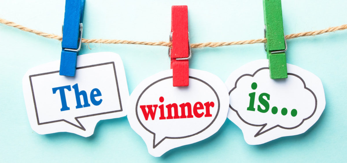 The winner is concept paper speech bubbles with line on the light blue background.