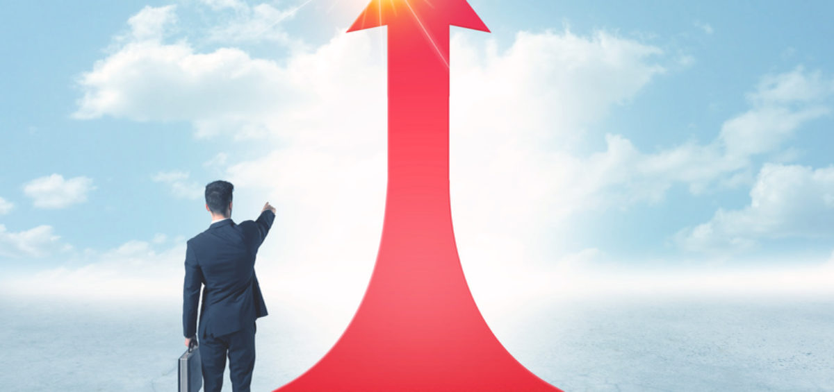 Concept of the road to success with a businessman standing on a red arrow