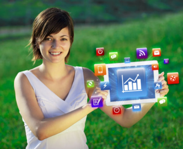 Young business woman looking at modern tablet with abstract lights and various icons