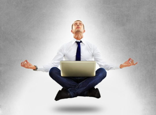 Businessman sitting in yoga position